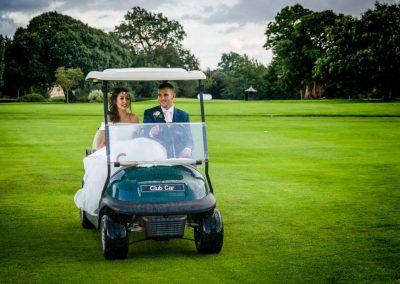 YFFUK Phil Endicott Gorman Harlestone Park Northampton Golf Club Northamptonshire groom driving the bride in a golf cart