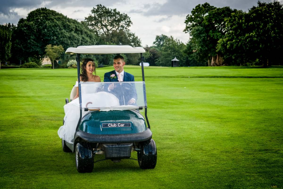 YFFUK Phil Endicott Gorman Harlestone Park Northampton Golf Club Northamptonshire groom driving the bride in a golf cart
