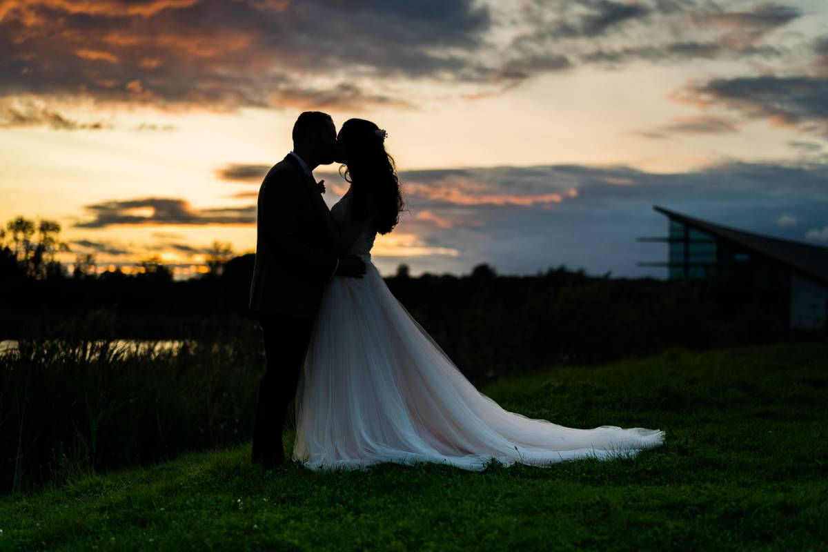 YFFUK Phil Endicott Johnson Stanwick Lakes Stanwick Northamptonshire groom bride at sunset coloured skies heart shape between them