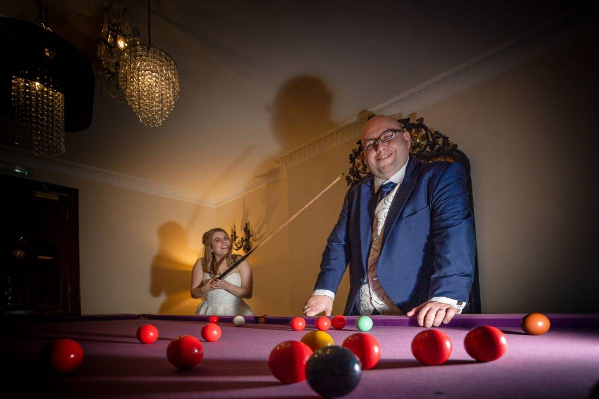 YFFUK Phil Endicott Lovegrove Oakley Court Windsor couple playing pool on their wedding day alternative to rain