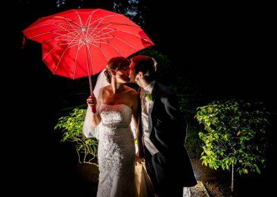 YFFUK Phil Endicott Martin Bull Hotel Gerrards Cross couple under a red heart umbrella