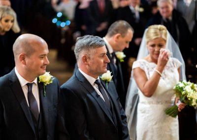YFFUK Phil Endicott Wilson St Mary Virgin Church Finedon bride dabbing a tear at bottom of aisle