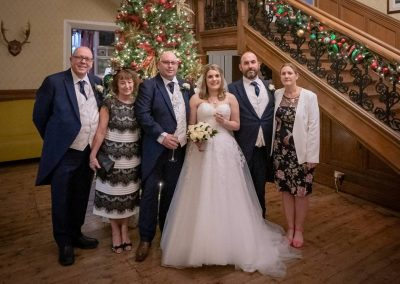 YFFUK Phil Endicott Lovegrove Oakley Court Windsor bridal party photo around the christmas tree