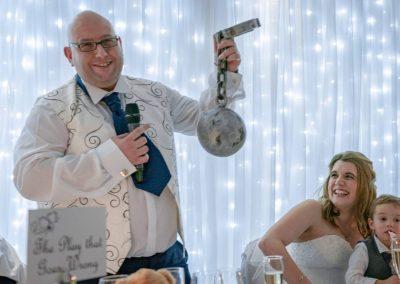 YFFUK Phil Endicott Lovegrove Oakley Court Windsor groom doing his wpeech holding a leg brace and cannonball