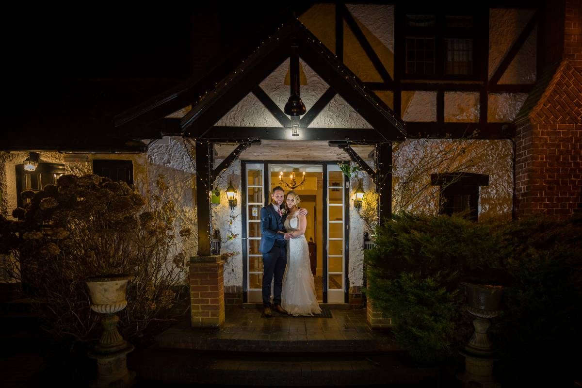 YFFUK Phil Endicott Norton Stanwick Hotel Courtyard Northamptonshire couple kissing in the archway of the cottage night lighting