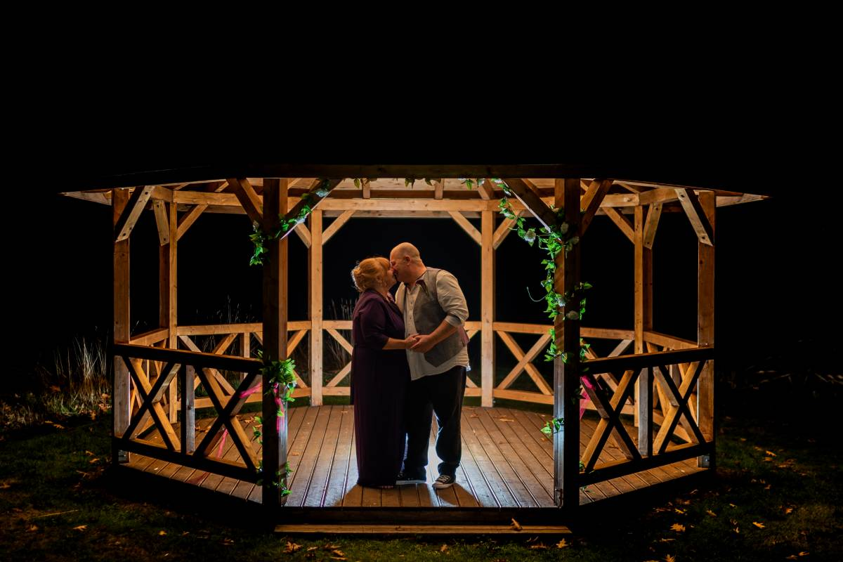 YFFUK Phil Endicott Powell Grovefield House Hotel Burnham Slough bride and groom cuddles in the night time light