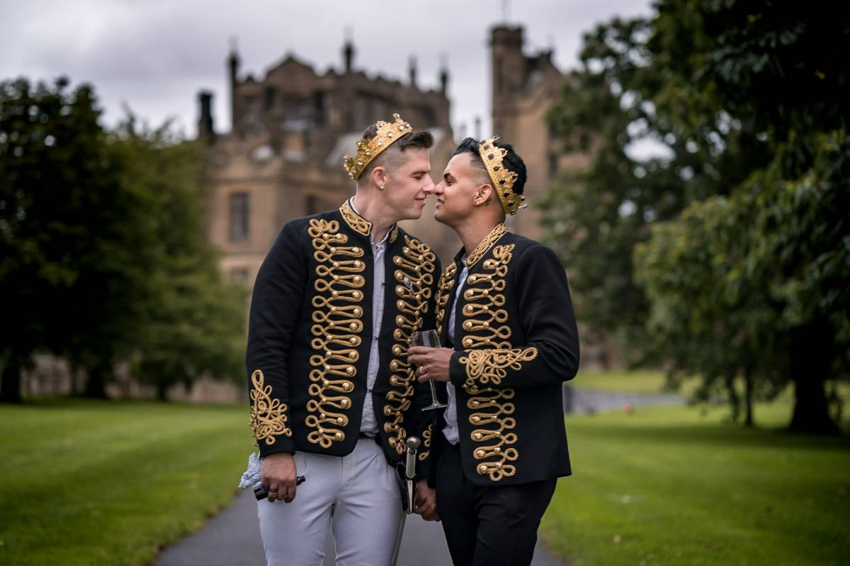 YFFUK Phil Endicott Hutchinson Allerton Castle Knaresborough grooms kissing outside the castle royal wedding