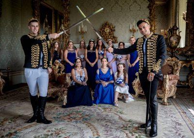 YFFUK Phil Endicott Hutchinson Allerton Castle Knaresborough group photo in the drawing room grooms holding swords aloft