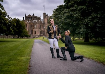 Weddings Photography Allerton Castle Knaresborough groom and groom playing on the driveway groom mock proposing