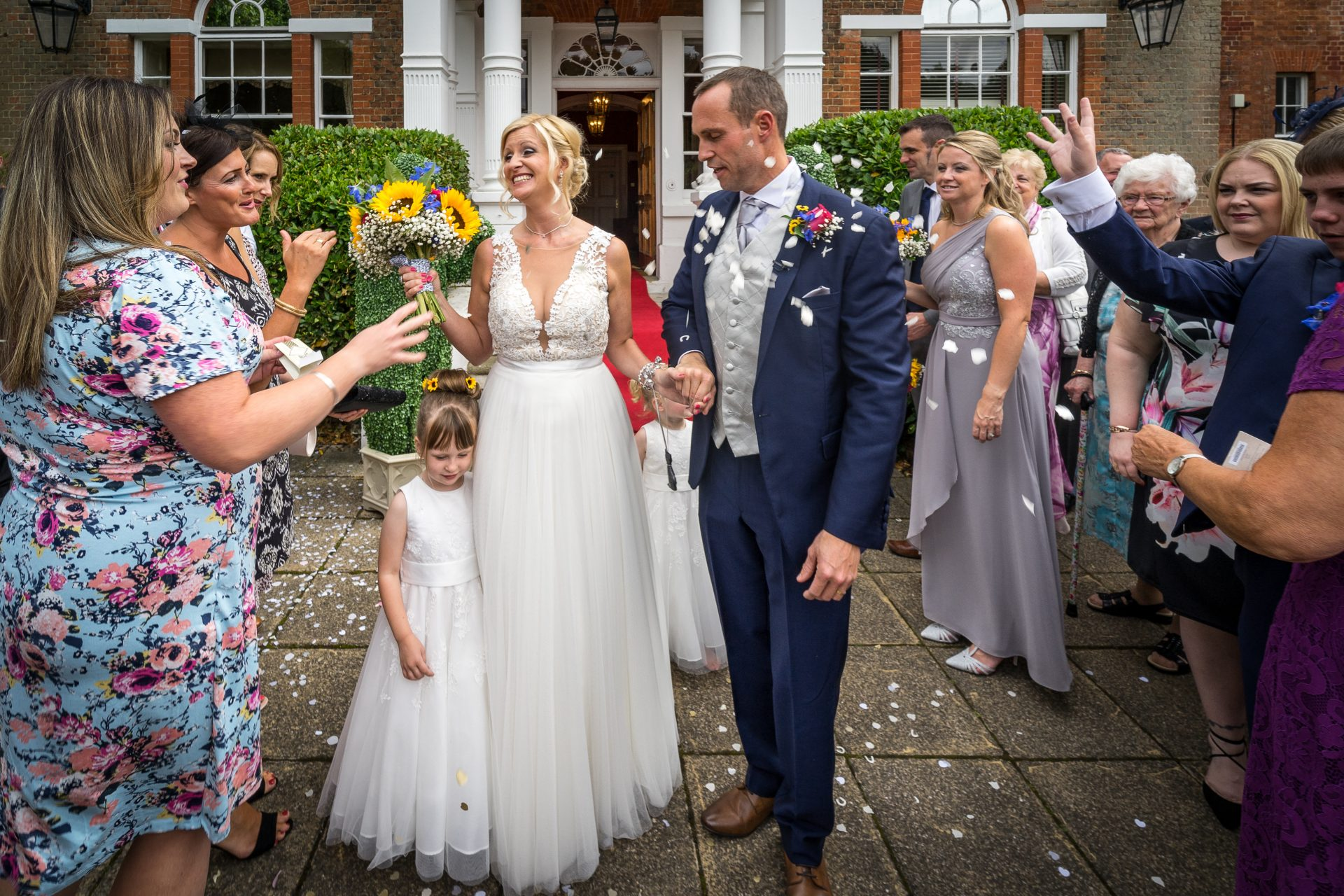 YFFUK Phil Endicott Murray Best Western Moore Place Hotel Aspley Guise bride and groom covered in confetti