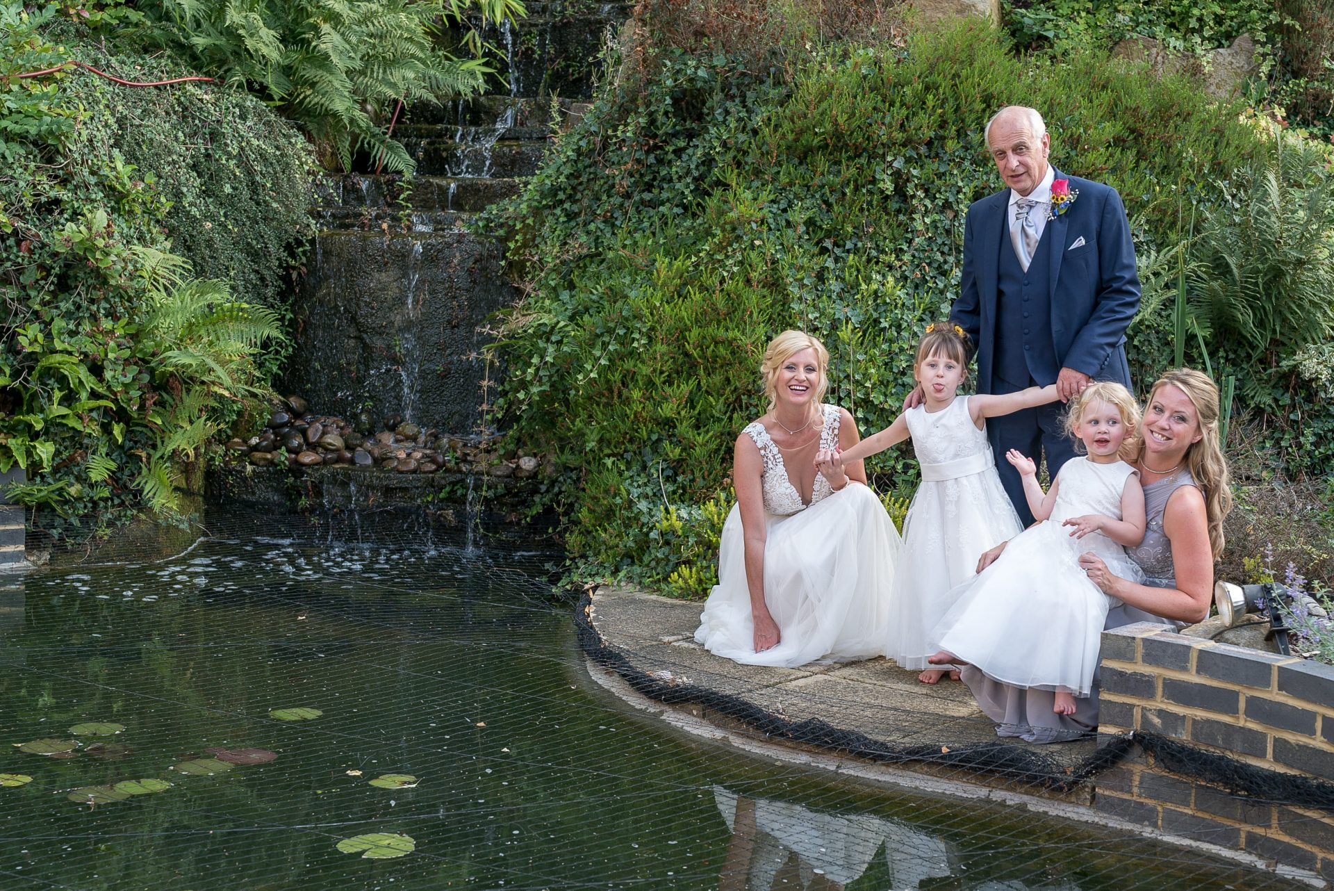 YFFUK Phil Endicott Murray Best Western Moore Place Hotel Aspley Guise bride bridesmaids and father by the waterfall