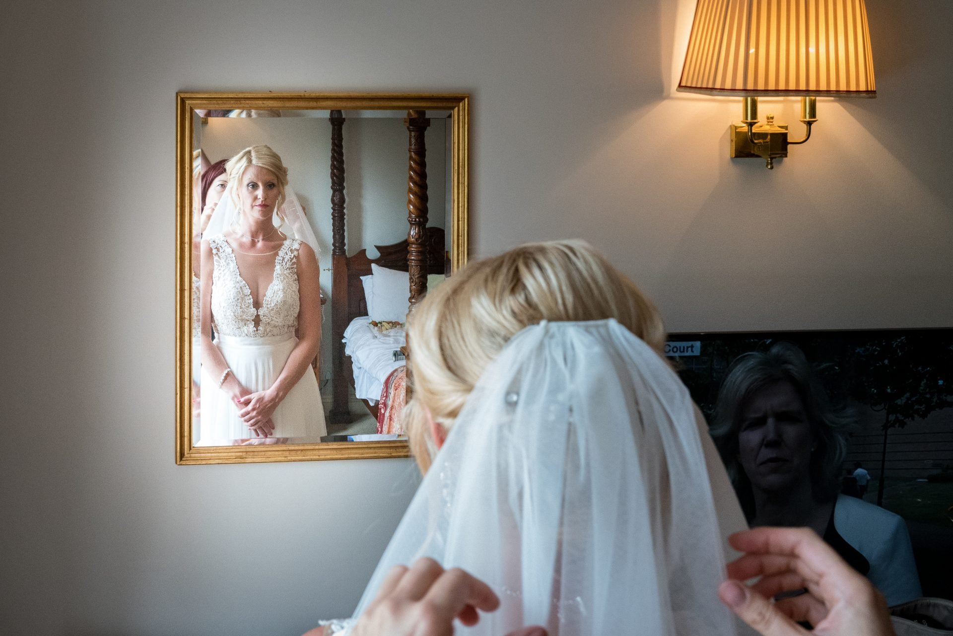 YFFUK Phil Endicott Murray Best Western Moore Place Hotel Aspley Guise bride having her veil fitted reflected in the mirror