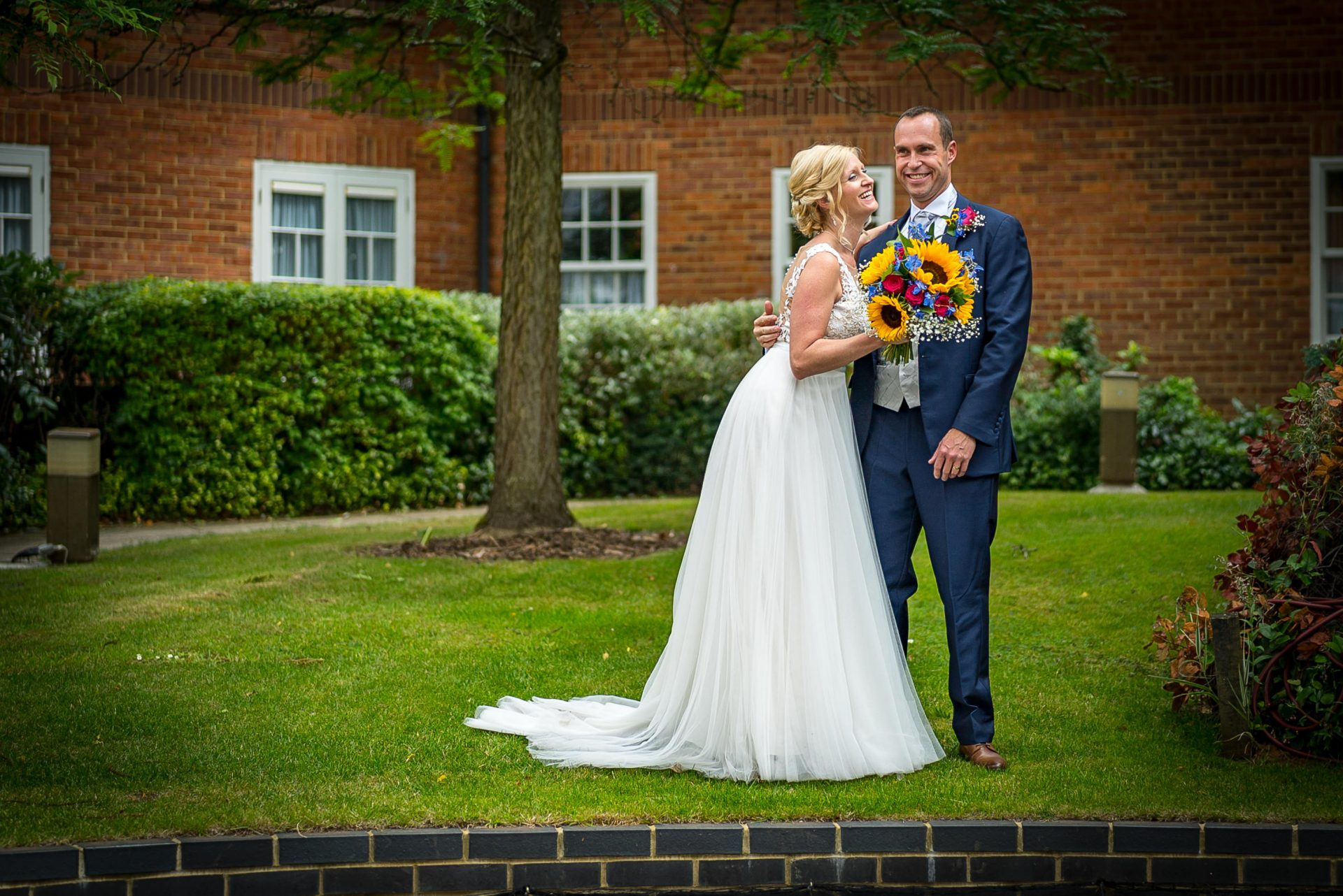 YFFUK Phil Endicott Murray Best Western Moore Place Hotel Aspley Guise newly married couple laughing on the grass courtyard