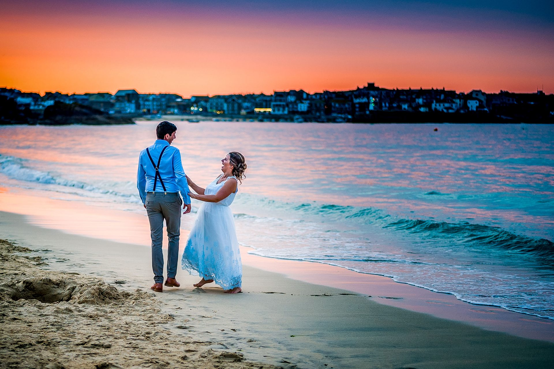 YFFUK Phil Endicott Pinto Porthminster Point Tregenna Castle St Ives bride laughing at groom walking along the beach sunset