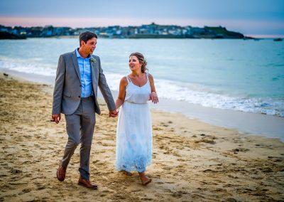 YFFUK Phil Endicott Pinto Porthminster Point Tregenna Castle St Ives groom bride hand in hand on the beach sun setting