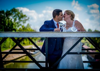 YFFUK Phil Endicott Sharpe Stoke Bruerne Northamptonshire bride and groom having a cuddle and special moment on the lock bridge
