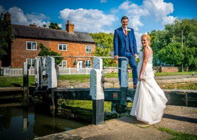 YFFUK Phil Endicott Sharpe Stoke Bruerne Northamptonshire bride and groom resting on the lock gates