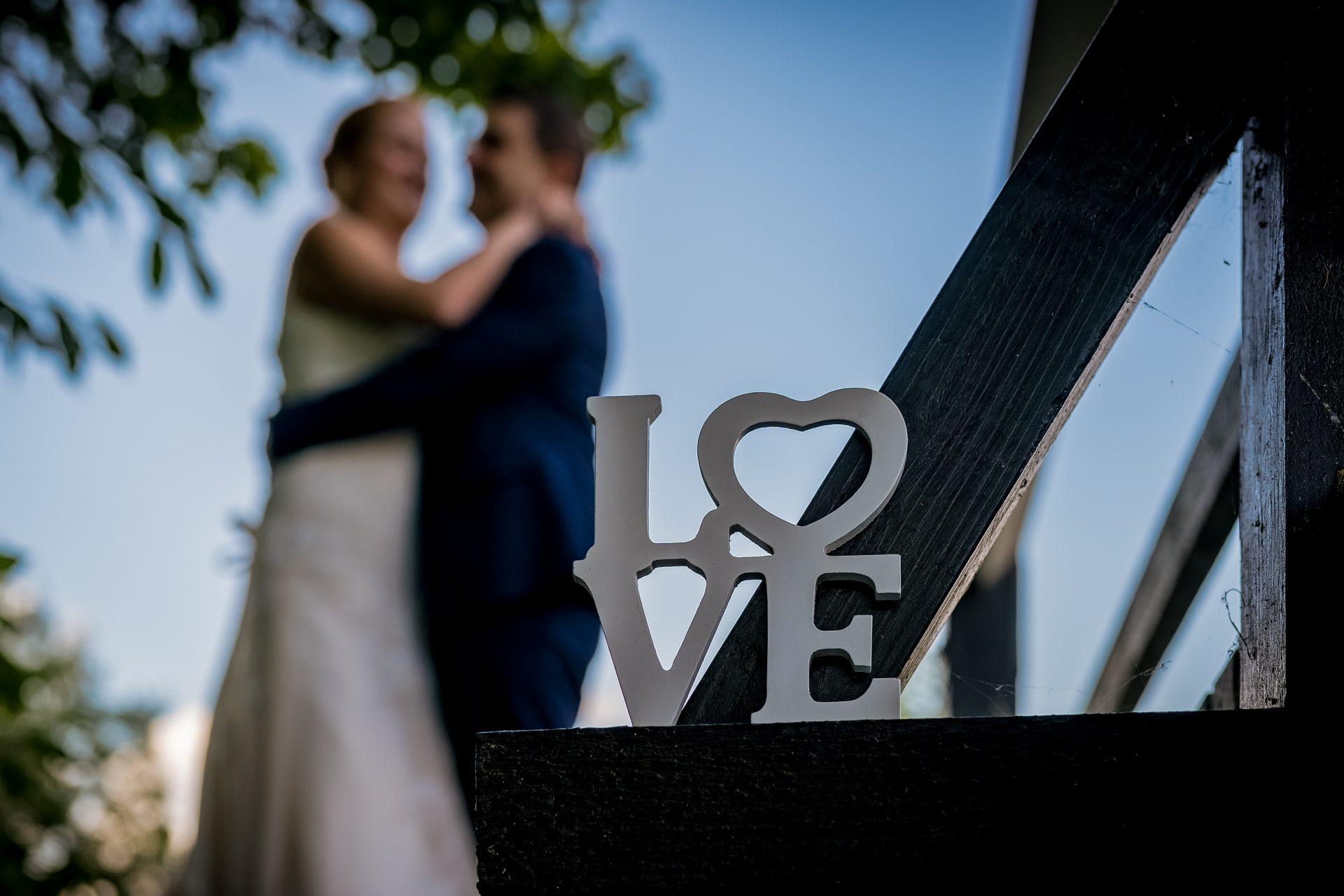 YFFUK Phil Endicott Sharpe Stoke Bruerne Northamptonshire bride groom cuddling by the lock gates love sign in forefround