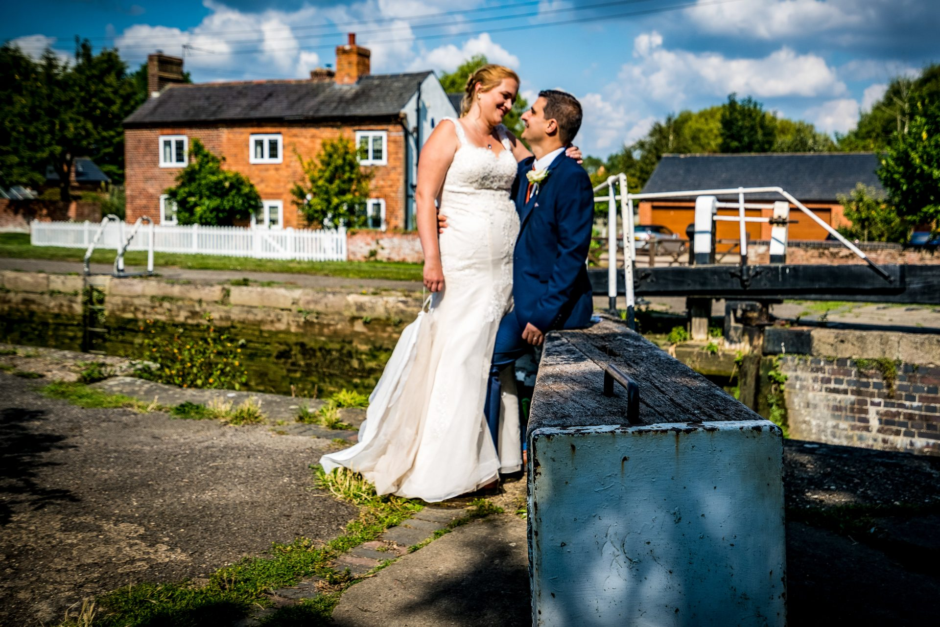 YFFUK Phil Endicott Sharpe Stoke Bruerne Northamptonshire bride kissing her husband by the lock gates