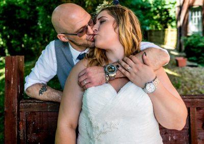 YFFUK Phil Endicott Zilka Holiday Inn Corby groom kissing bride over the fence