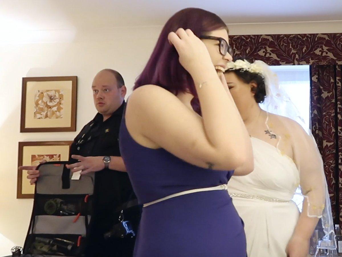 YFFUK Phil Endicott Useful things bride and bridesmaid hugging phil taking pictures in the corner