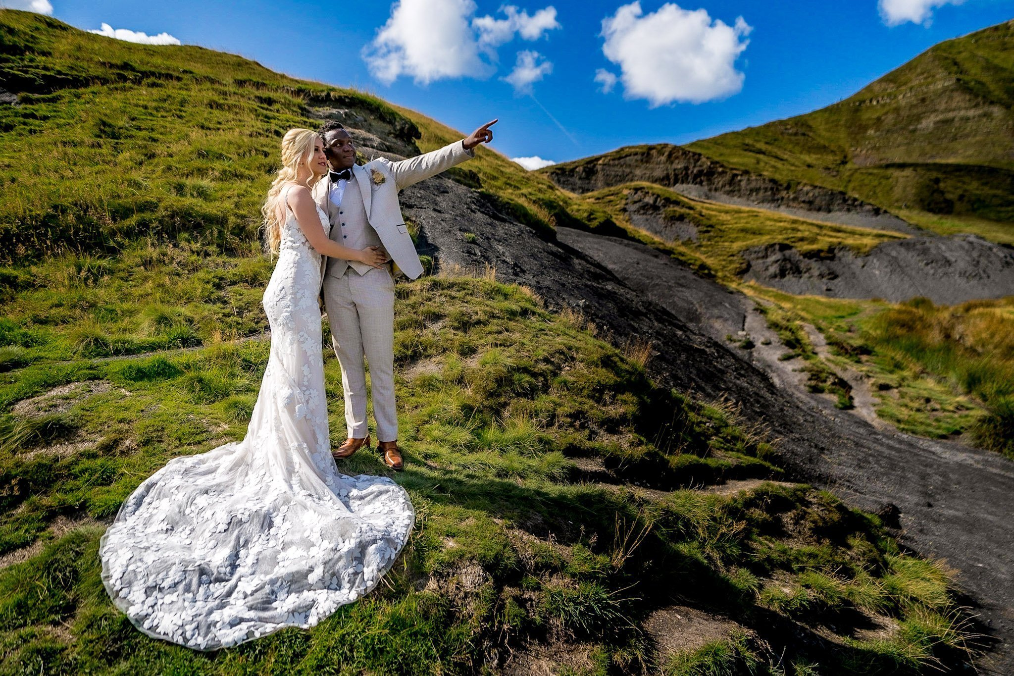 YFFUK Your Favourite Frame Mwasuku Peak District Castleton Mam Tor Bridal bride and groom looking at the mountain top