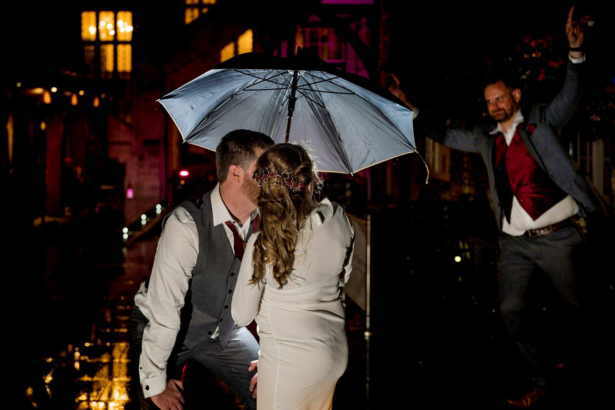 YFFUK Your Favourite Frame Talbot Hotel Oundle bridesman photobombing the couple during night photos umbrella rain