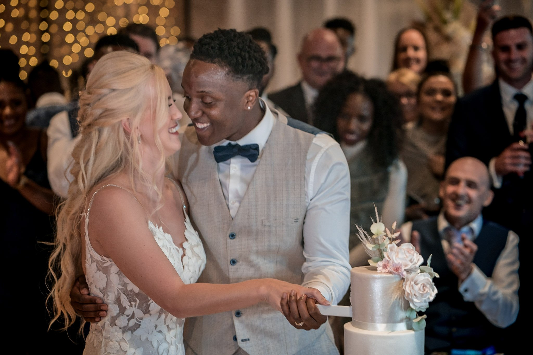 Your Favourite Frame YFFUK Mwasuku Norton Fields Atherstone bride and groom cutting the cake