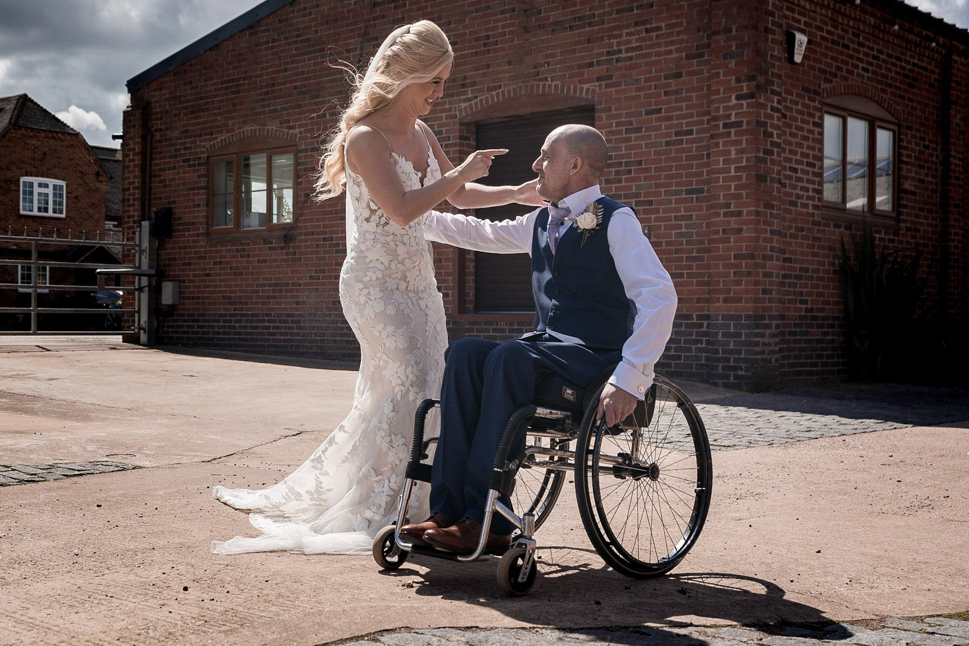 Your Favourite Frame YFFUK Mwasuku Norton Fields Atherstone bride greeting her father who is seeing her in her wedding dress for the first time telling him not to cry