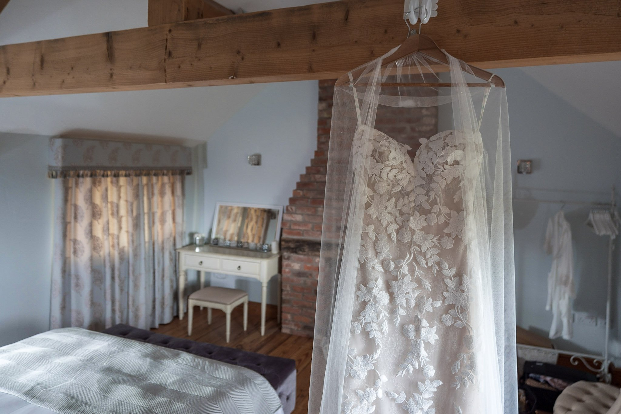 Your Favourite Frame YFFUK Mwasuku Norton Fields Atherstone brides dress hanging in the bridal suite waiting to be put on