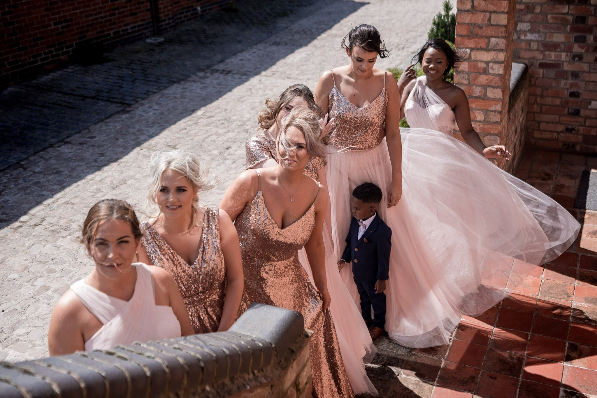 Your Favourite Frame YFFUK Mwasuku Norton Fields Atherstone bridesmaids waiting at the bottom of the outside staircase for the bride to arrive