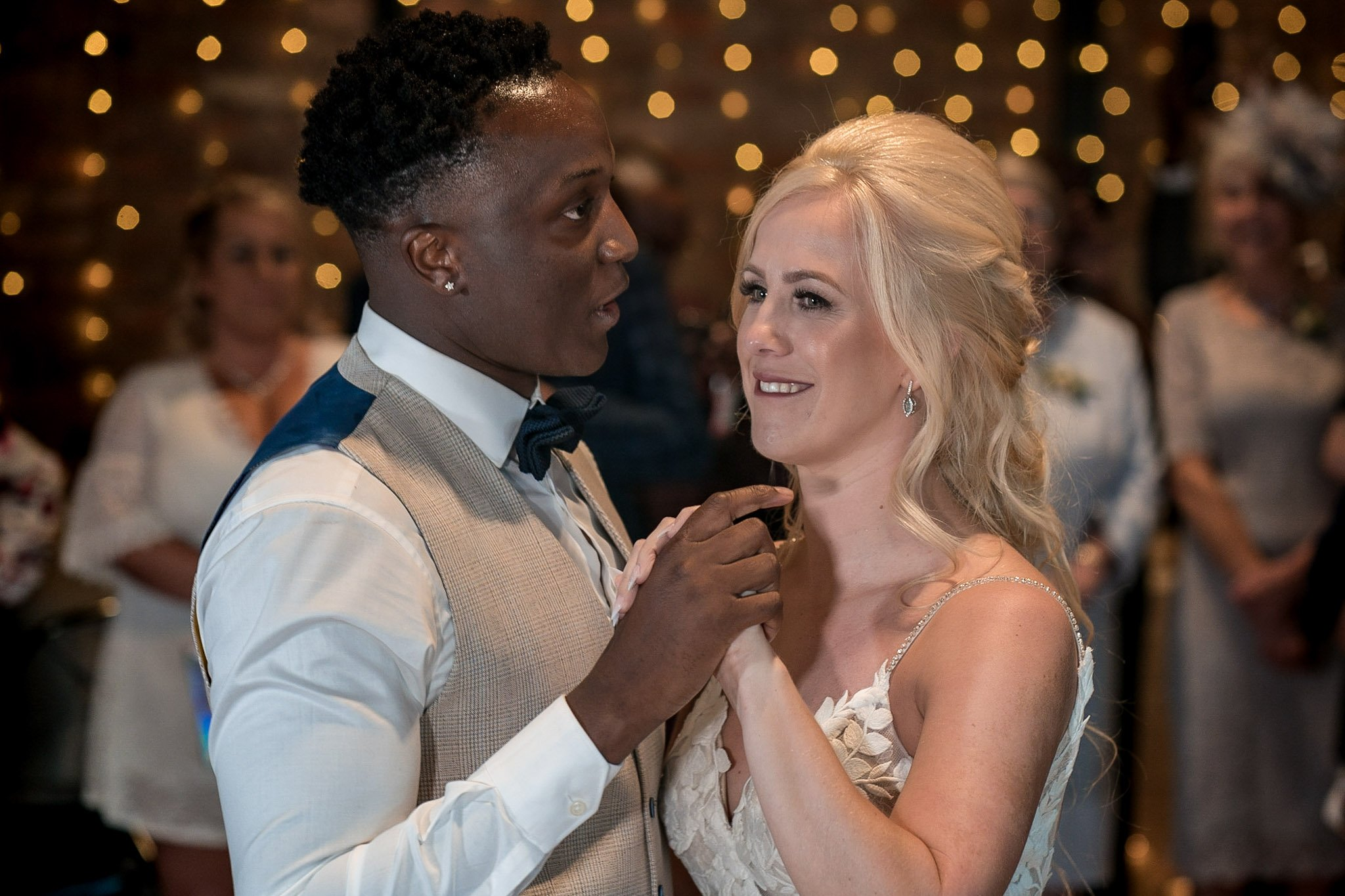 Your Favourite Frame YFFUK Mwasuku Norton Fields Atherstone first dance moment bride and groom close contact hand in hand