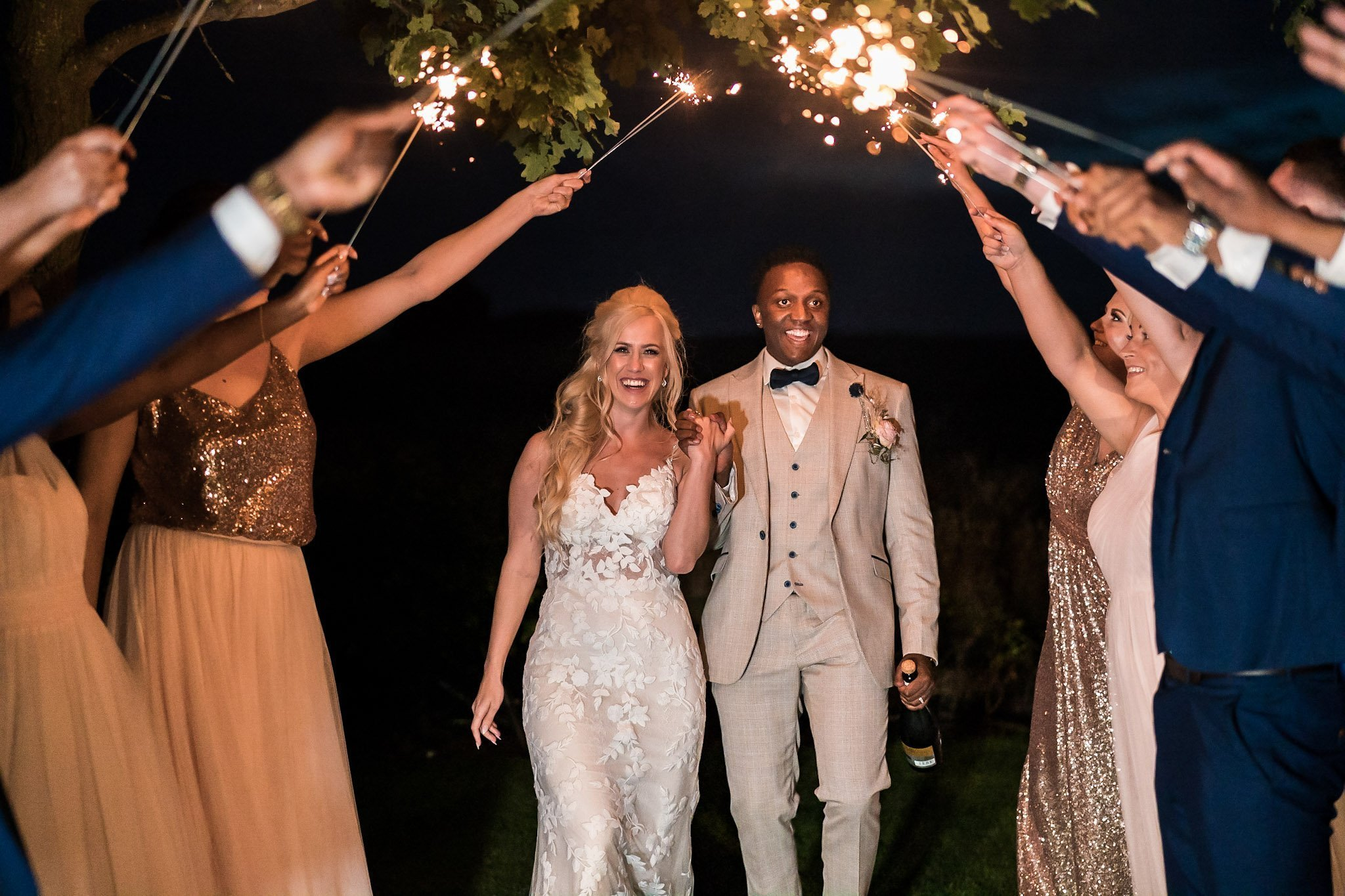 Your Favourite Frame YFFUK Mwasuku Norton Fields Atherstone sparkler arch over the bride and groom