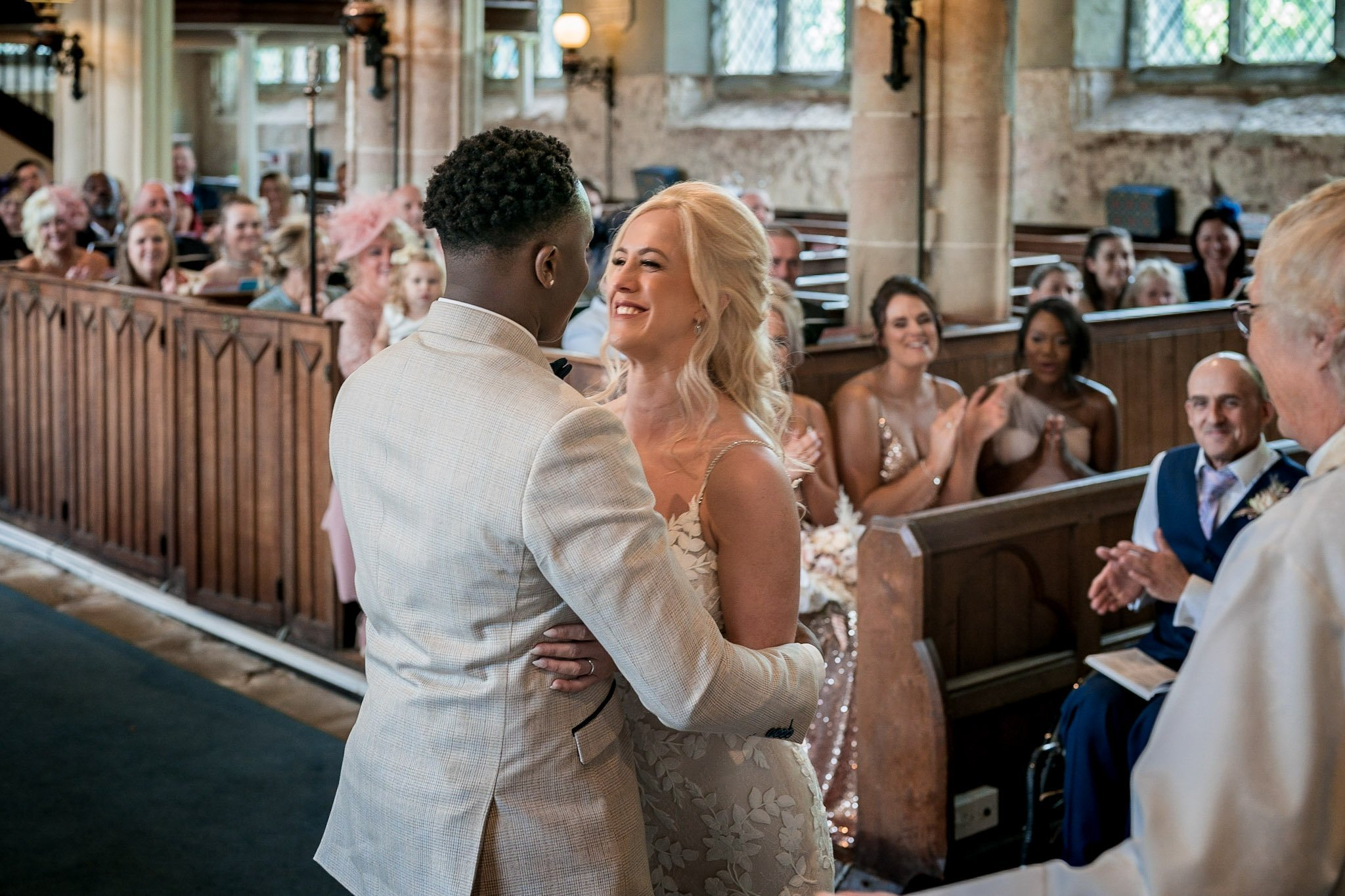 Your Favourite Frame YFFUK Mwasuku St Michaels Church Appleby Magna bride and groom having their first kiss as husband and wife smiles all around