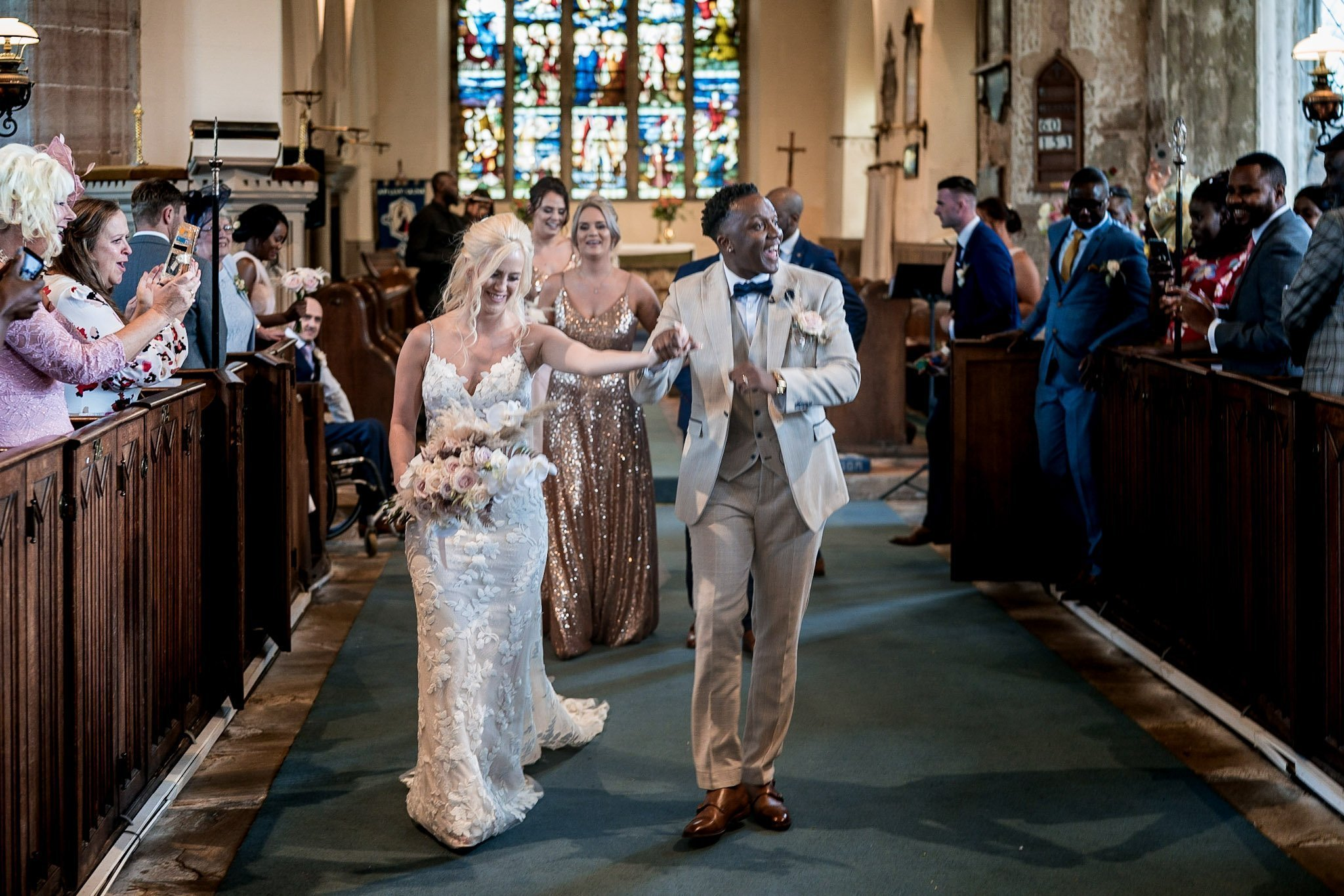 Your Favourite Frame YFFUK Mwasuku St Michaels Church Appleby Magna bride and groom walking back down the aisle having a little groove to themselves