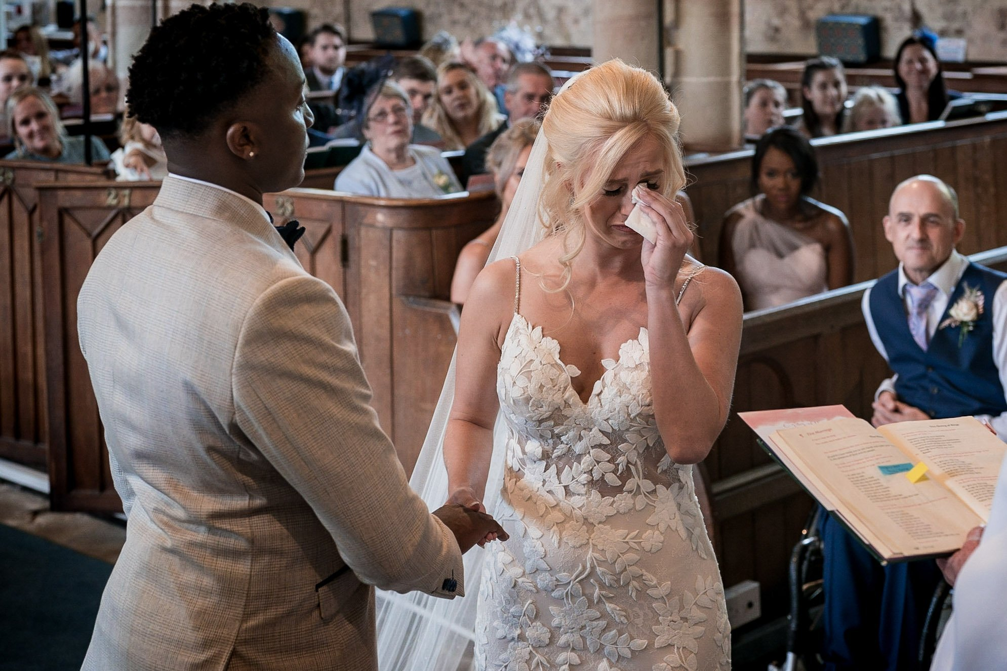 Your Favourite Frame YFFUK Mwasuku St Michaels Church Appleby Magna bride dabbing away tears with a borrowed tissue as the vows get too emotional father looking on from behind proud as punch