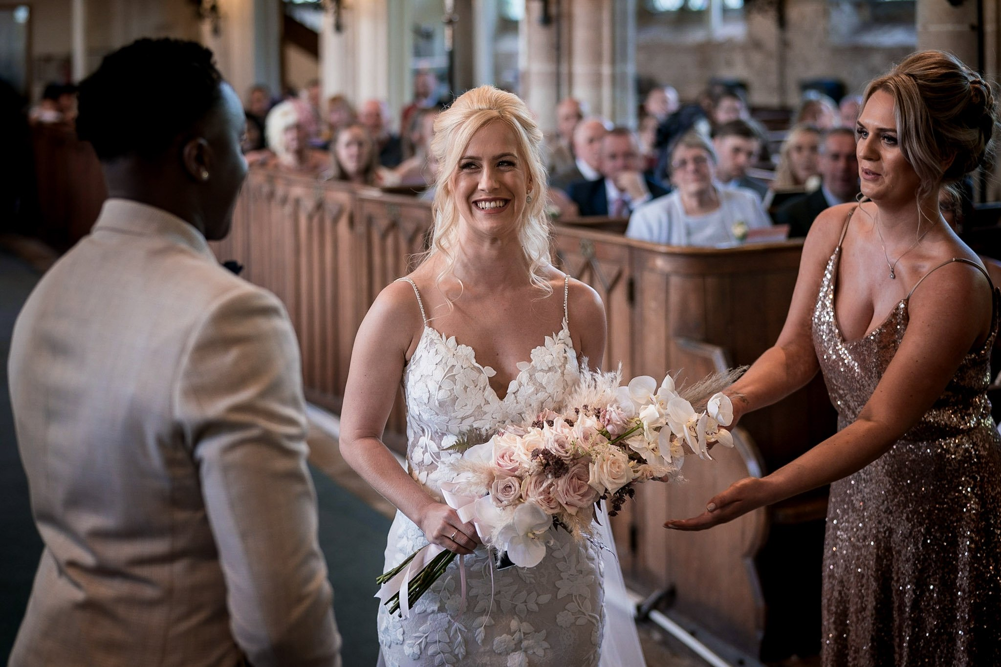 Your Favourite Frame YFFUK Mwasuku St Michaels Church Appleby Magna bride reaching the front of the aisle and beaming at her husband to be maid of honour trying to steal the bouquet