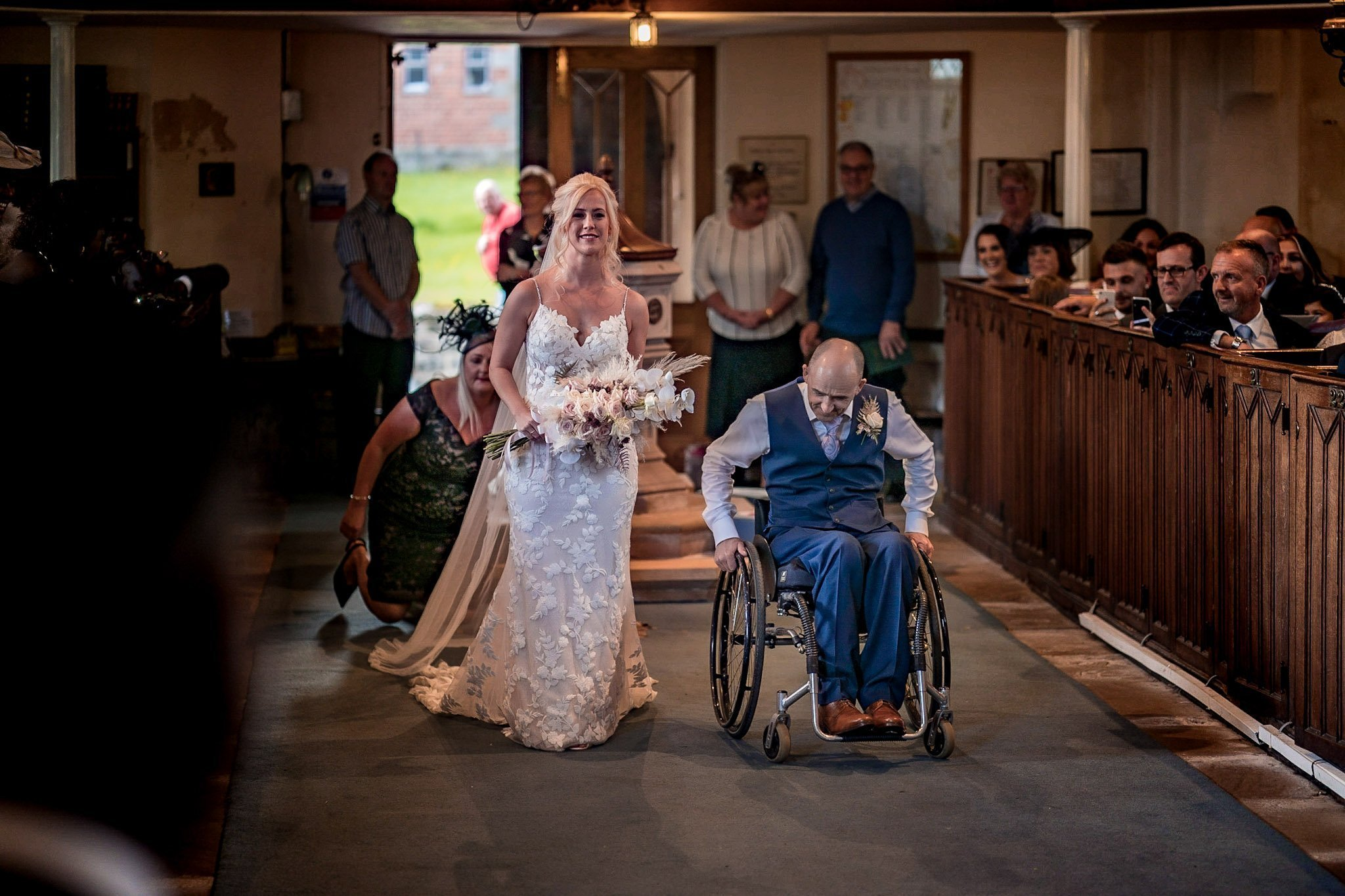 Your Favourite Frame YFFUK Mwasuku St Michaels Church Appleby Magna bride walking the aisle with a huge smile on her face