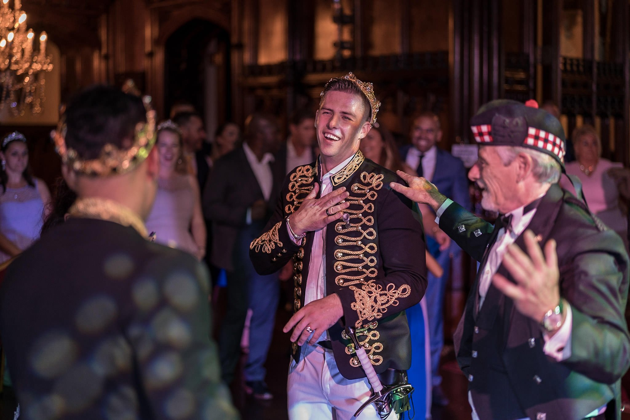 Allerton Castle Knaresborough Hutchinson Weddings Photography Groom laughing with his father during dancing in the great hall