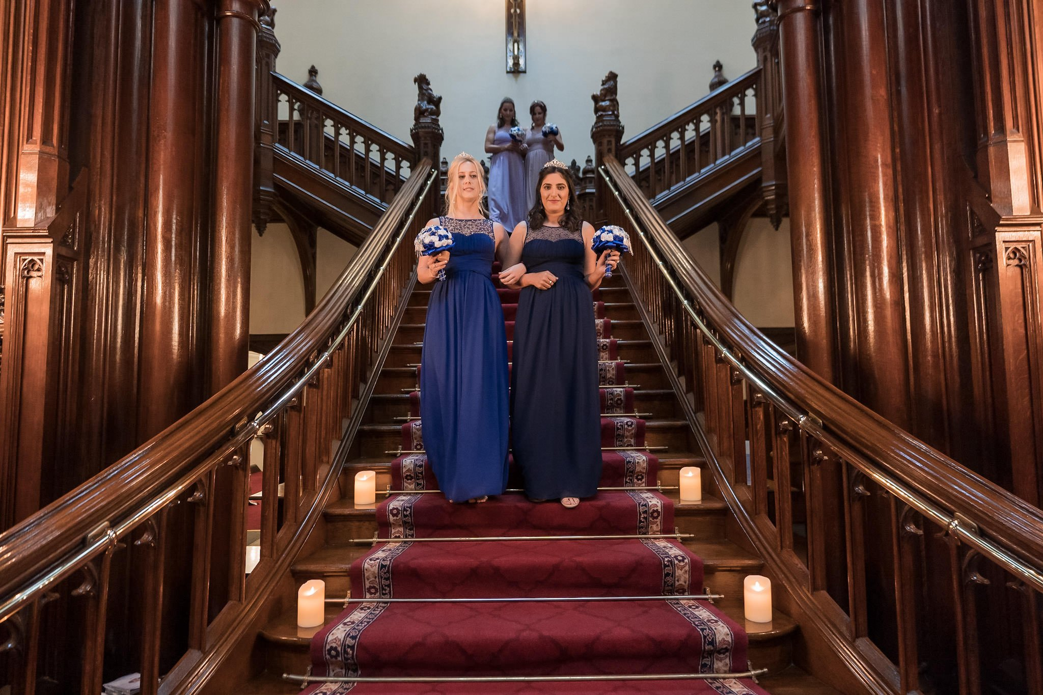 Allerton Castle Knaresborough Hutchinson Weddings Photography bridesmaids on the grand staircase