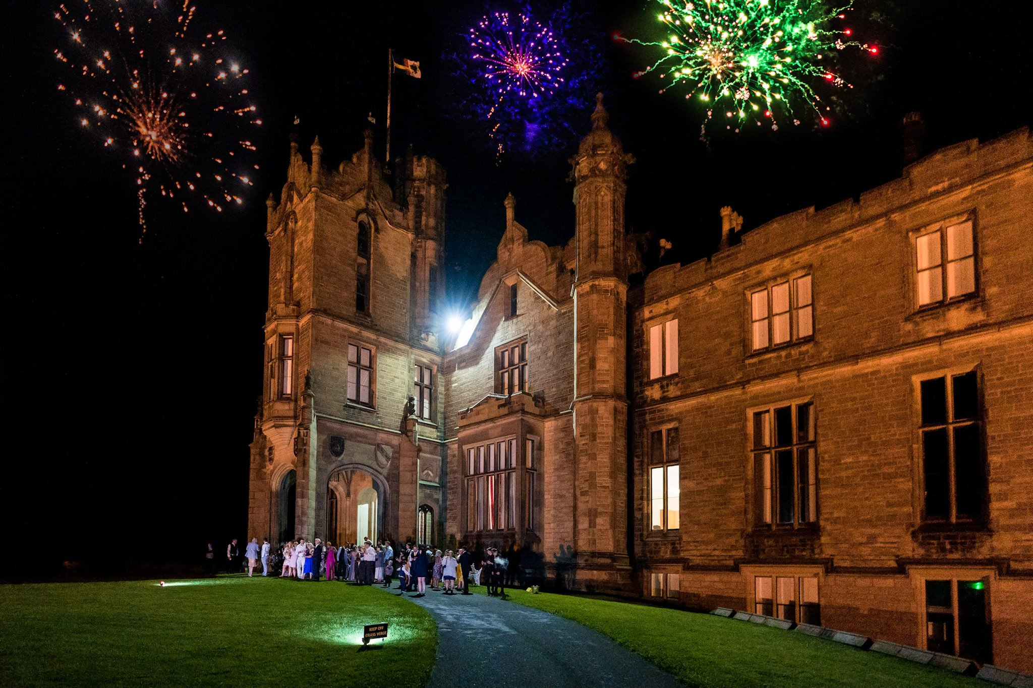 Allerton Castle Knaresborough Hutchinson Weddings Photography fireworks over the castle exploding in style after a magical wedding day