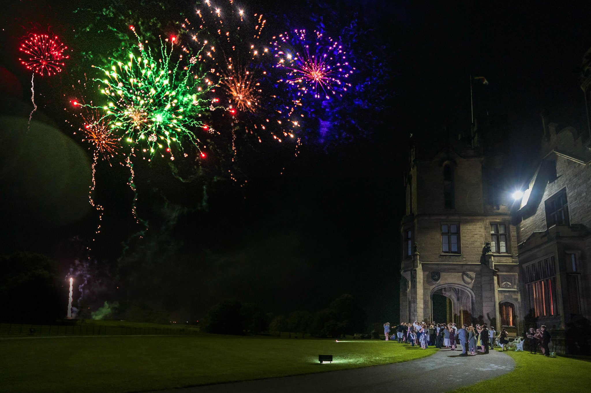 Allerton Castle Knaresborough Hutchinson Weddings Photography fireworks over the castle mass of light beautiful colours