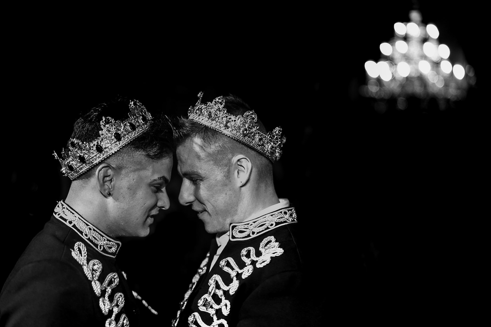 Allerton Castle Knaresborough Hutchinson Weddings Photography groom and groom head to head during first dance in the great hall chandelier providing light black and white