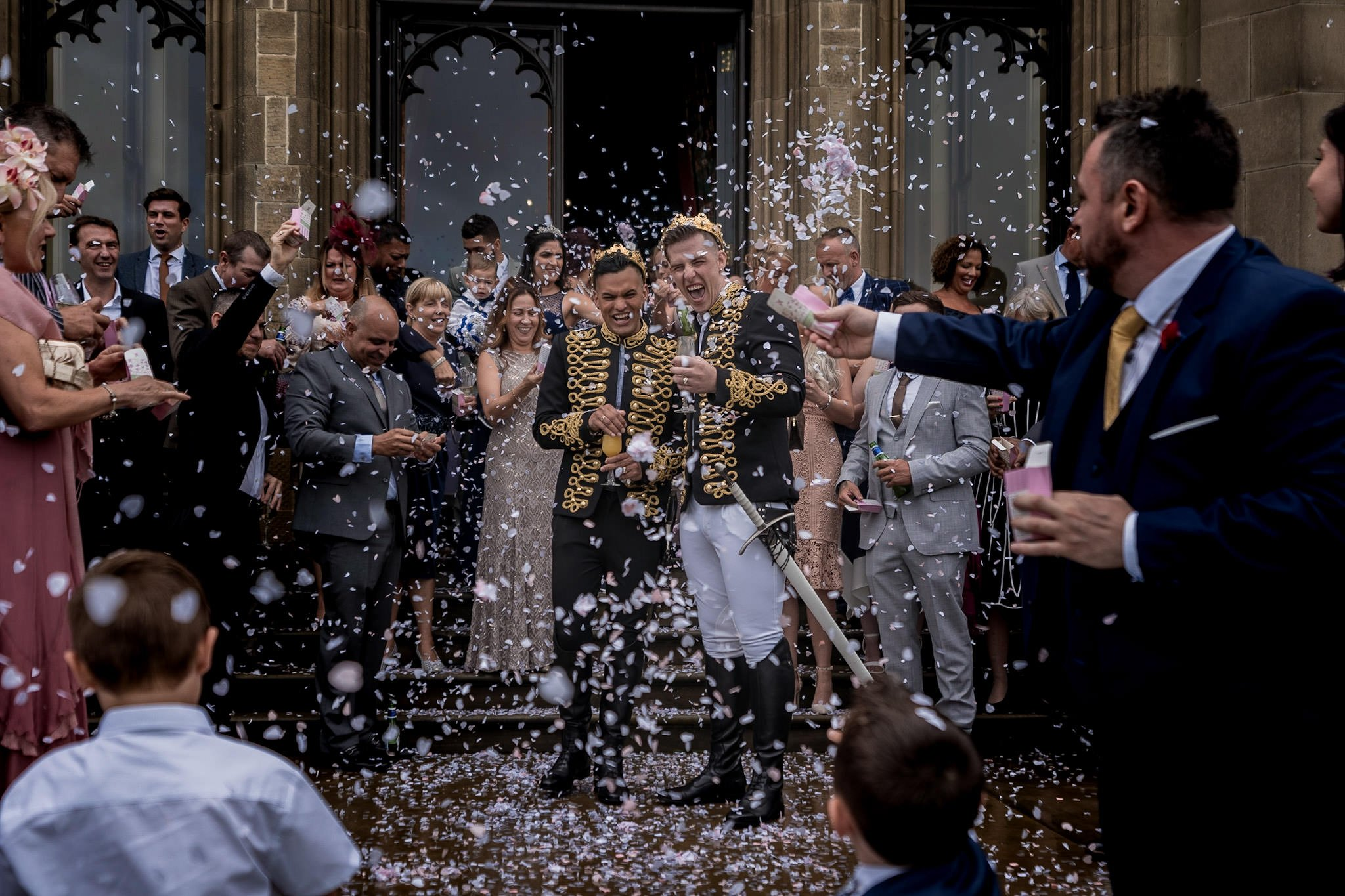 Allerton Castle Knaresborough Hutchinson Weddings Photography groom and husband covered in confetti guest with hand in with a huge box