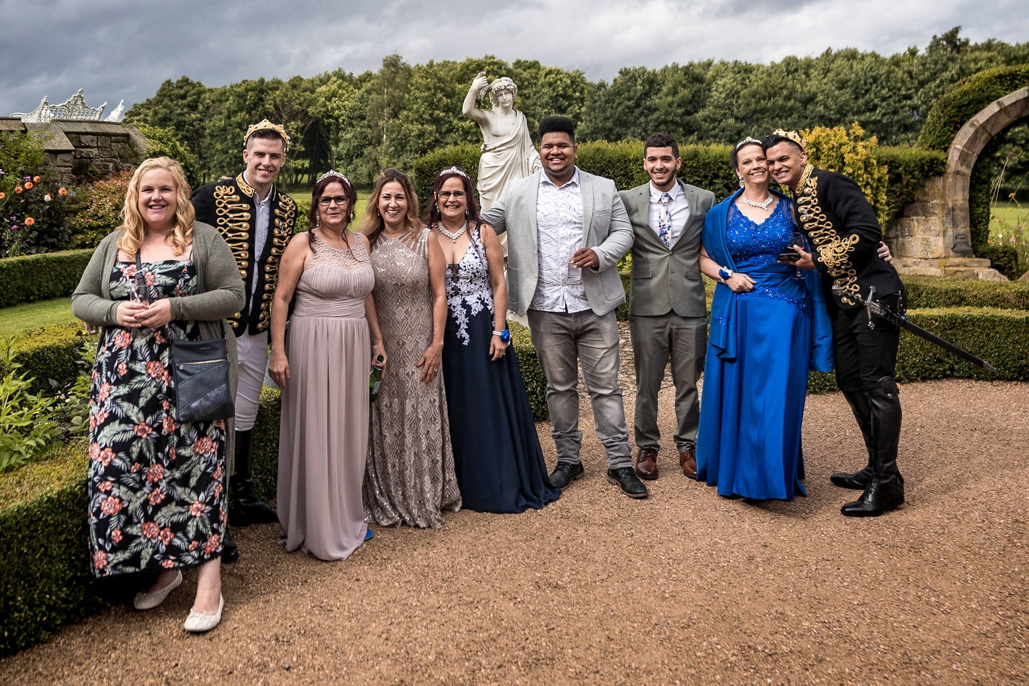 Allerton Castle Knaresborough Hutchinson Weddings Photography groom and husband with guests in the memorial gardens