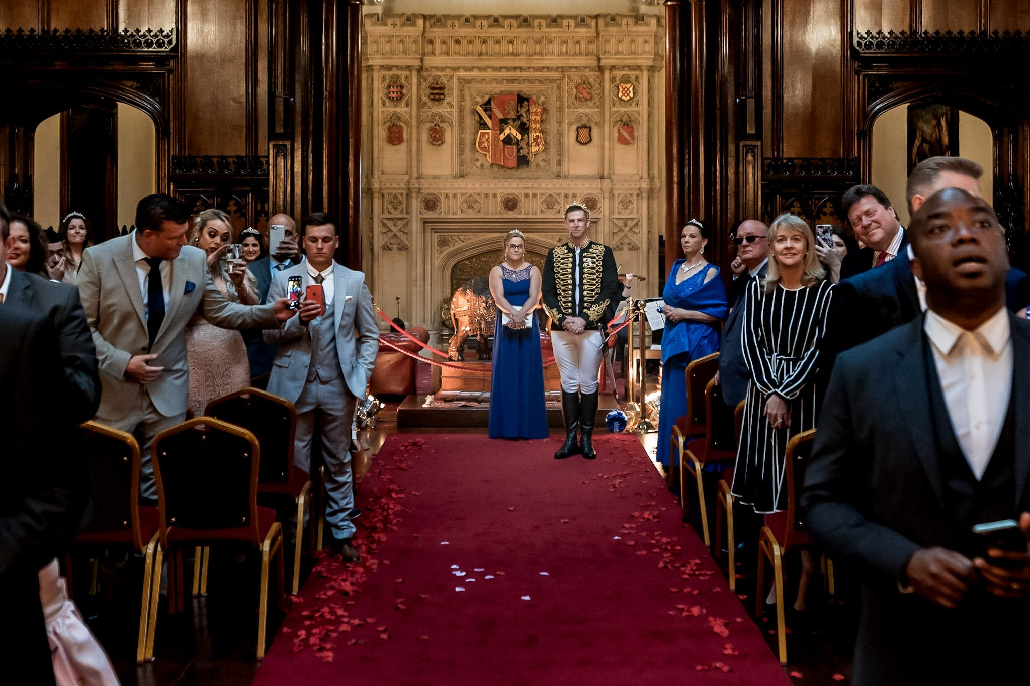 Allerton Castle Knaresborough Hutchinson Weddings Photography groom waiting at the top of the aisle as his husband to be walks down the grand staircase