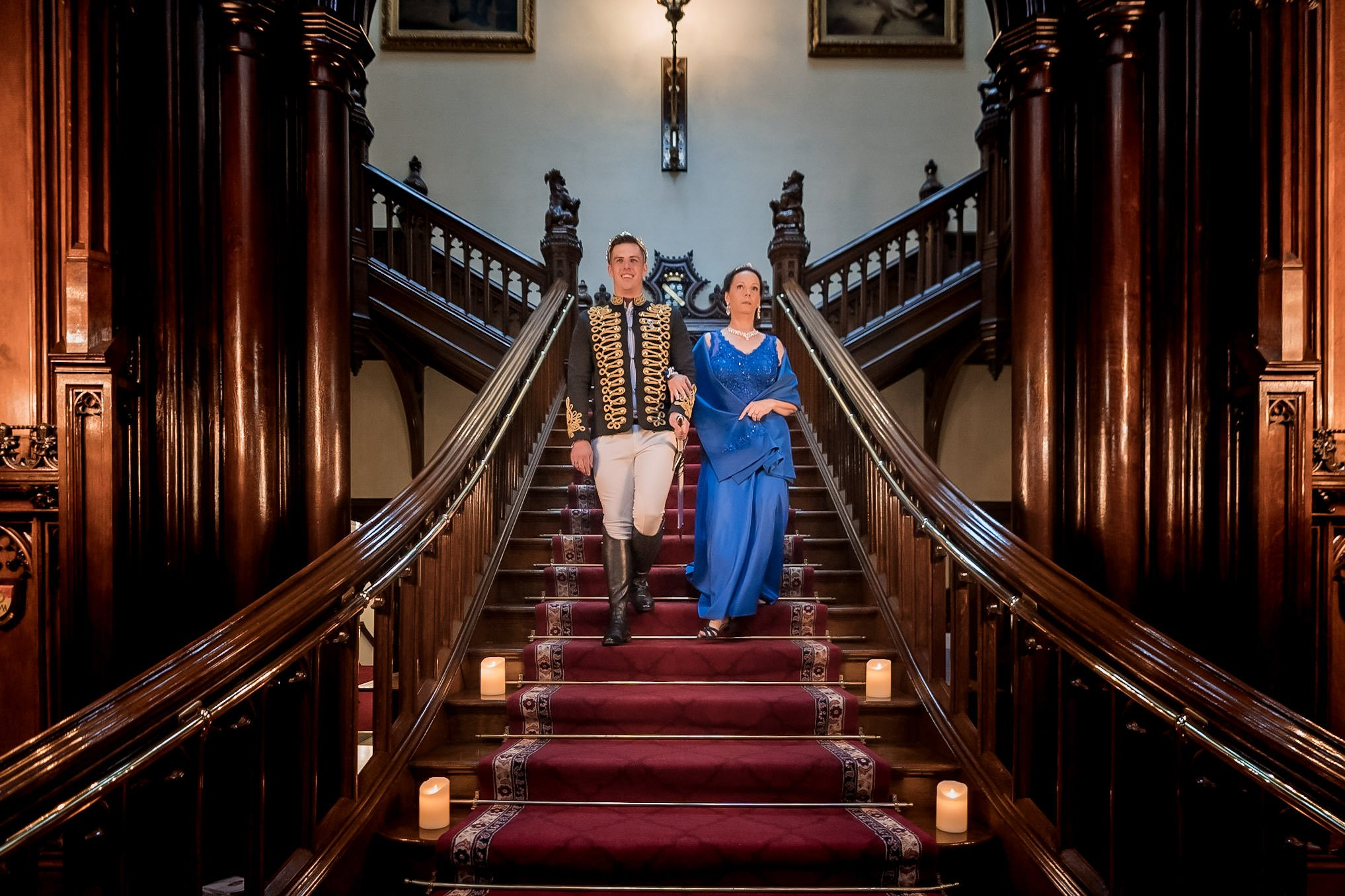 Allerton Castle Knaresborough Hutchinson Weddings Photography groom walking down the grand staircase to his wedding ceremony with his mother mum escorting him