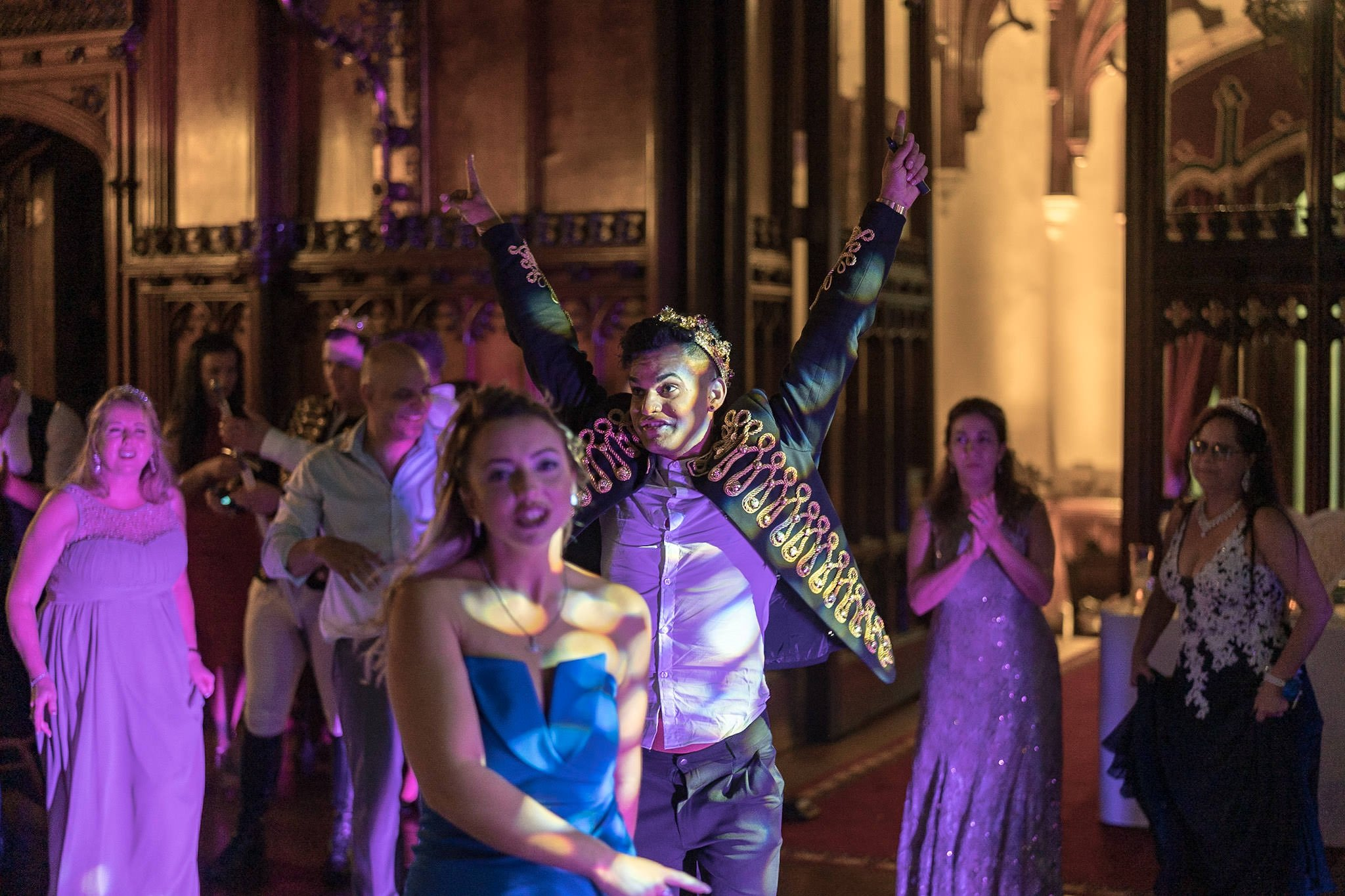 Allerton Castle Knaresborough Hutchinson Weddings Photography groom with his arms in the air celebrating his wedding day and dancing