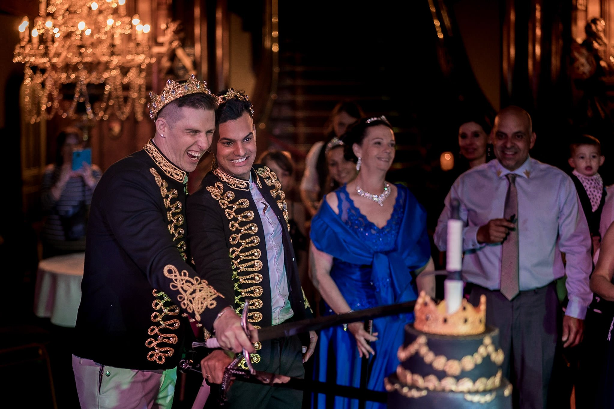 Allerton Castle Knaresborough Hutchinson Weddings Photography husband and husband cutting the cake with their swords