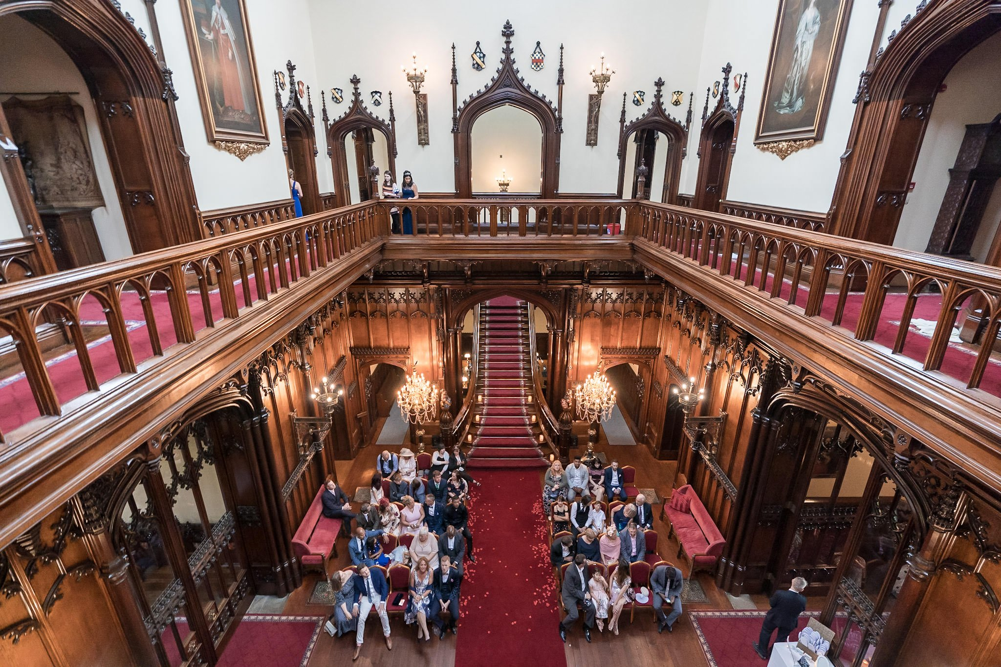 Allerton Castle Knaresborough Hutchinson Weddings Photography looking down on the great hall from above showing the guests waiting for the bridal party